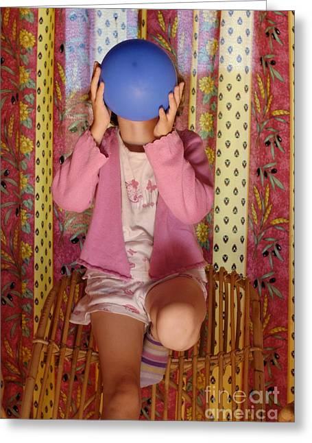 Pajamas Photographs Greeting Cards - Girl blowing up balloon Greeting Card by Sami Sarkis
