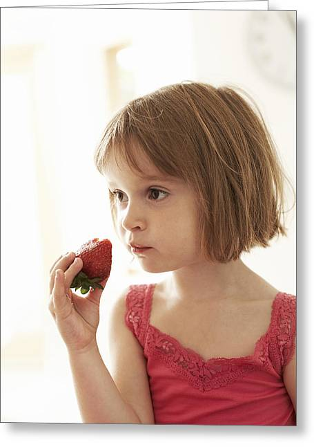 Kid Eating Snack Greeting Cards - Girl Eating A Strawberry Greeting Card by Ian Boddy