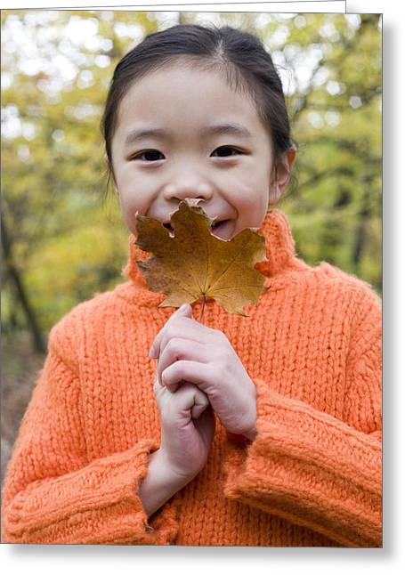 Shyness Greeting Cards - Girl Holding An Autumn Leaf Greeting Card by Ian Boddy