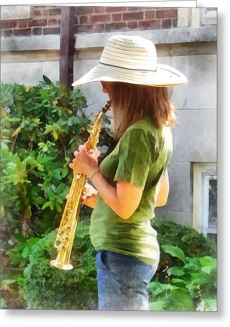 Saxophones Greeting Cards - Girl Playing Saxophone Greeting Card by Susan Savad