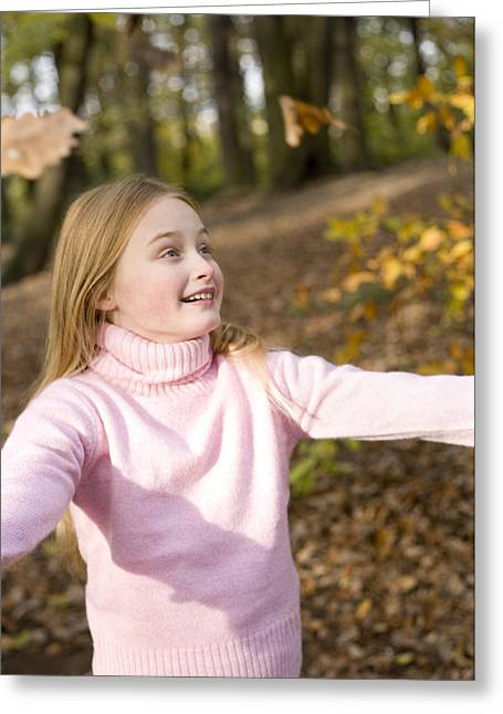 Child Care Greeting Cards - Girl Playing With Autumn Leaves Greeting Card by Ian Boddy