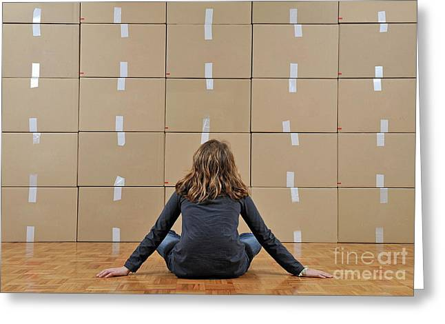 Cardboard Greeting Cards - Girl seated in front of cardboard boxes Greeting Card by Sami Sarkis