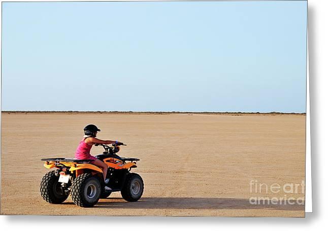 Solitariness Greeting Cards - Girl speeding on ATV in desert Greeting Card by Sami Sarkis