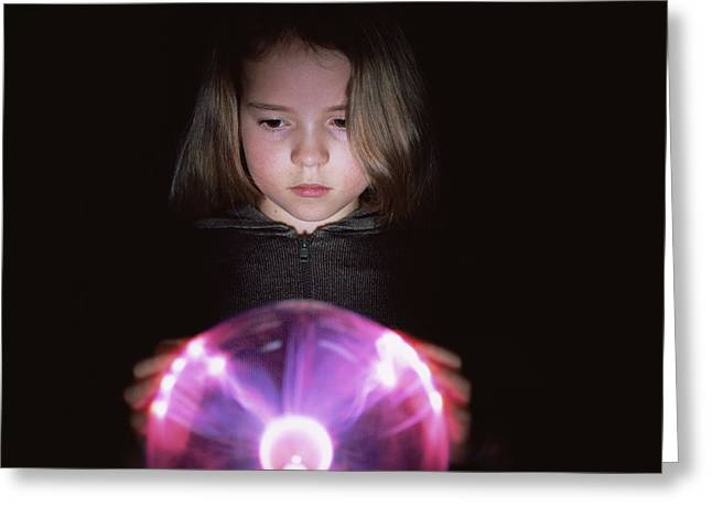 Plasma Greeting Cards - Girl Touching A Plasma Globe Greeting Card by Kevin Curtis