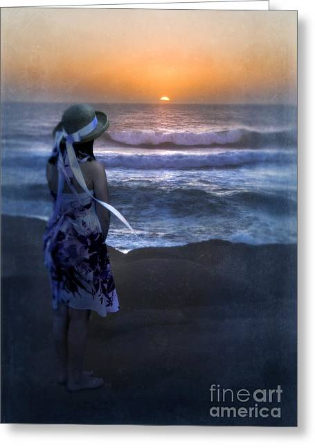 Sun Hat Greeting Cards - Girl Watching the Sun Go Down at the Ocean Greeting Card by Jill Battaglia