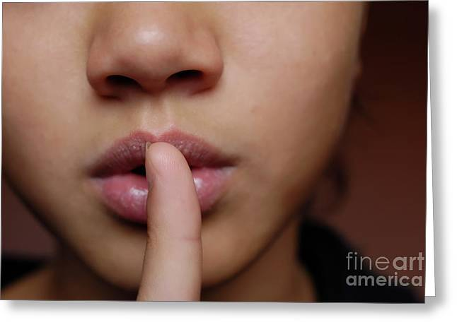 Girl with finger on lips Greeting Card by Sami Sarkis