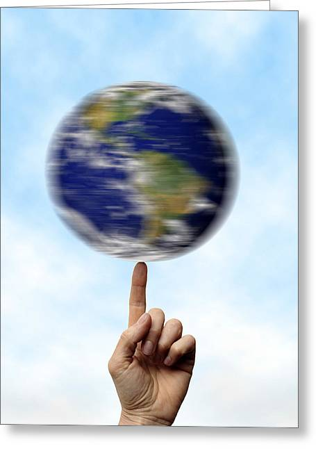 Moving Earth Greeting Cards - Globe Spinning On A Finger Greeting Card by Cordelia Molloy