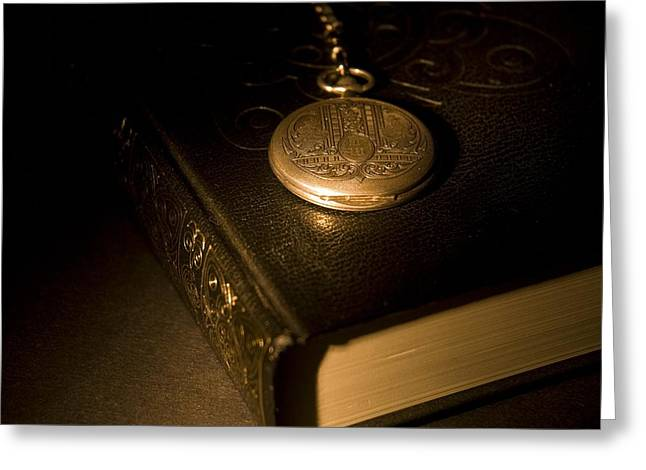 Gold Pocket Watch Resting On A Book Greeting Card by Philippe Widling