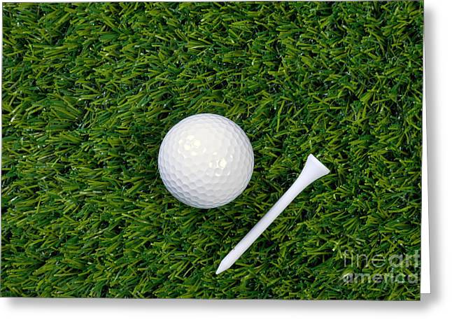 Golf Photos Greeting Cards - Golf ball and tee on grass Greeting Card by Richard Thomas