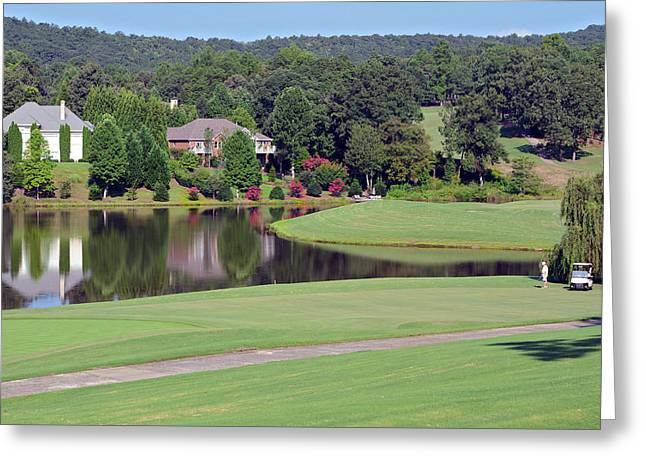 Golfer At Lake  Greeting Card by Susan Leggett