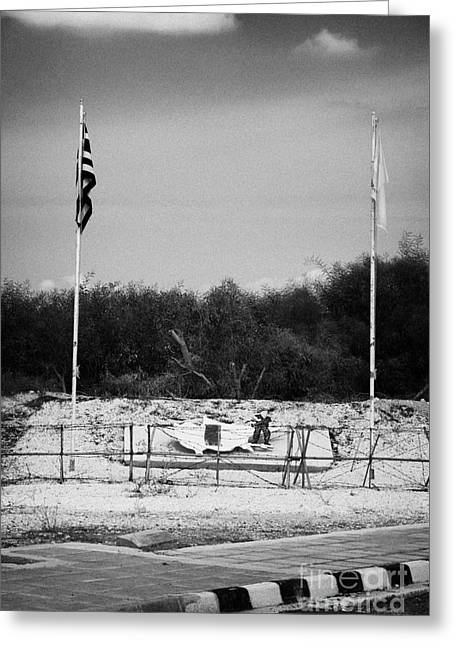 Deryneia Greeting Cards - greek cypriot army memorial sign at the UN buffer zone in the green line dividing cyprus Greeting Card by Joe Fox
