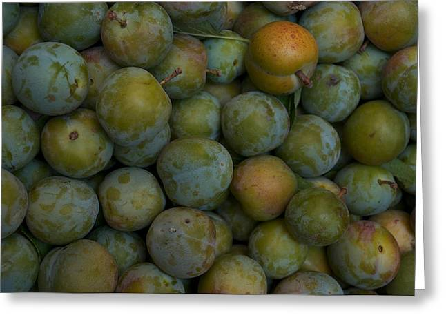 Italian Shopping Photographs Greeting Cards - Green Plums Fill A Bin Outside A Local Greeting Card by Heather Perry