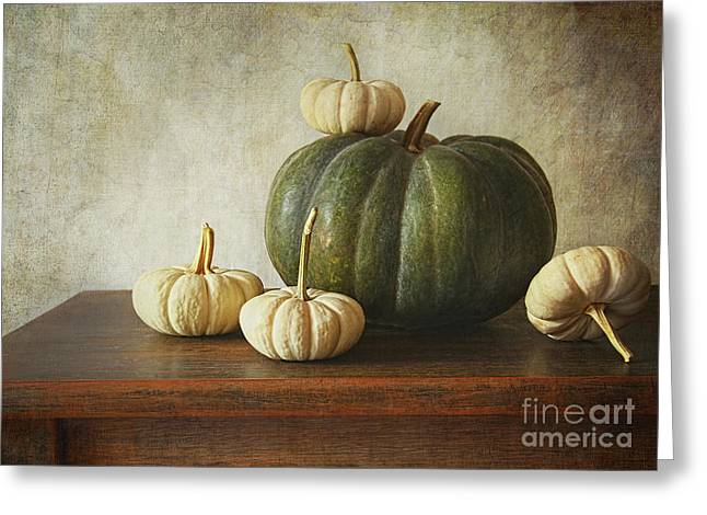 Melon Greeting Cards - Green pumpkin and gourds on table  Greeting Card by Sandra Cunningham