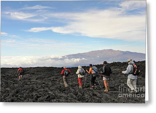 45-49 Years Greeting Cards - Group of hickers walking on cooled lava Greeting Card by Sami Sarkis