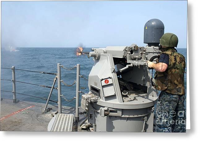 Artillery Gun Greeting Cards - Gunners Mate Fires A 25mm Chain Gun Greeting Card by Stocktrek Images
