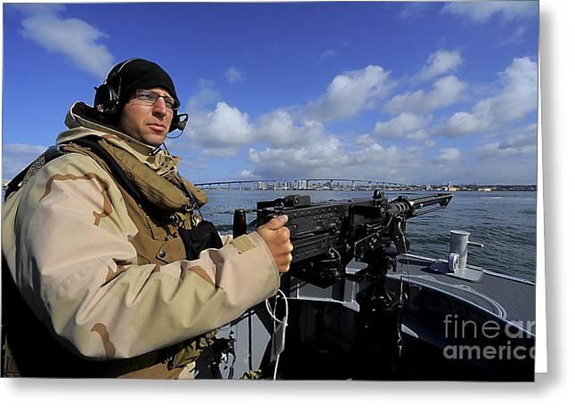 Gunners Mate Mans An M2 Hb .50-caliber Greeting Card by Stocktrek Images