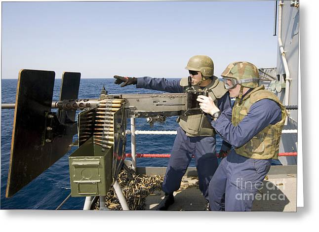 Fed Greeting Cards - Gunners Mates Fire A .50-caliber Greeting Card by Stocktrek Images