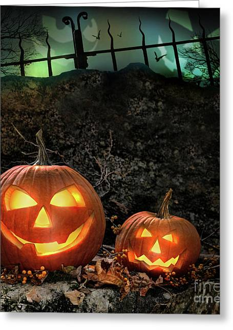 Backlit Greeting Cards - Halloween pumpkins on rocks  at night Greeting Card by Sandra Cunningham