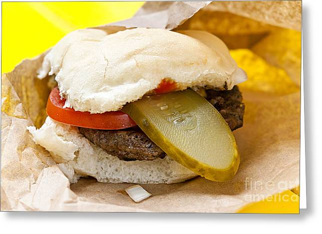Bun Photographs Greeting Cards - Hamburger with pickle and tomato Greeting Card by Elena Elisseeva