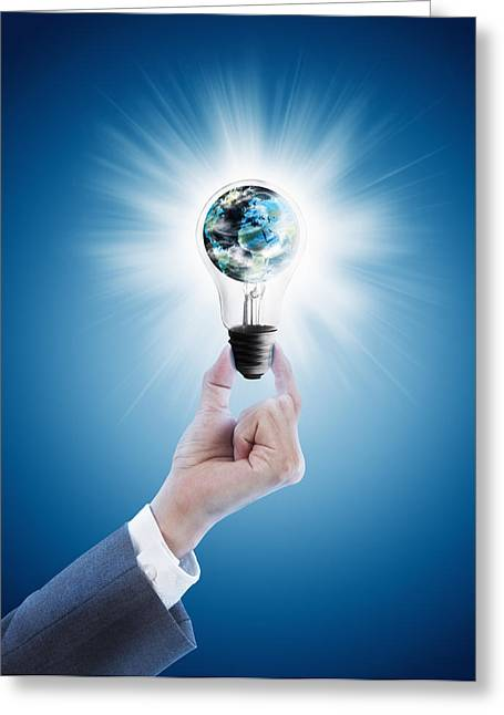 Blue Glass World Greeting Cards - Hand holding light bulb with globe  Greeting Card by Setsiri Silapasuwanchai