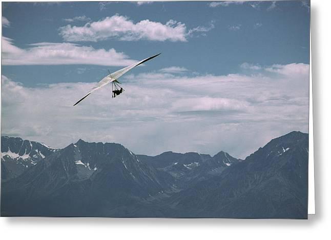 Hang Glider Pilot Flies In Front Greeting Card by Gordon Wiltsie