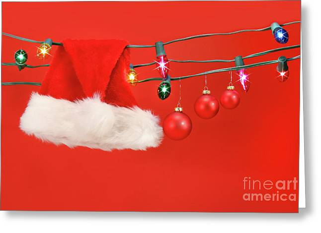 Hanging lights with santa hat Greeting Card by Sandra Cunningham
