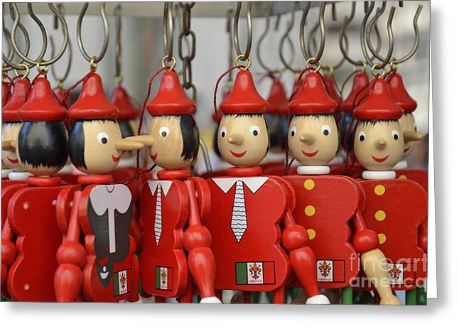 Hanging Pinocchios puppets Greeting Card by Sami Sarkis