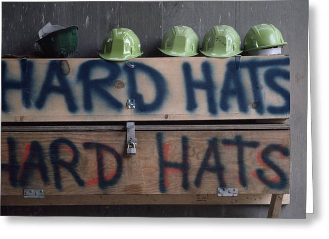 Hard Hat Greeting Cards - Hard Hats At A Construction Site Greeting Card by Lynn Johnson