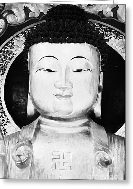 Shatin Greeting Cards - Head Face And Shoulders Of Large Golden Buddha Statue Showing Buddhist Swastika Symbol Greeting Card by Joe Fox