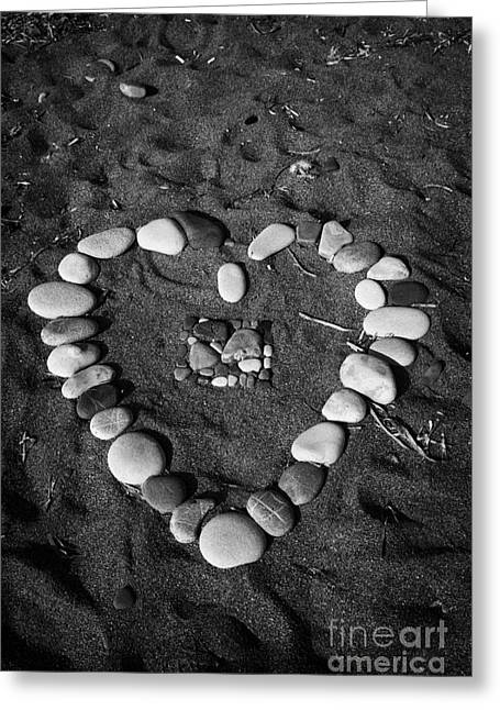 Petra Greeting Cards - Heart Symbol Made Out Of Pebbles On The Beach At Aphrodites Rock Petra Tou Romiou Cyprus Greeting Card by Joe Fox