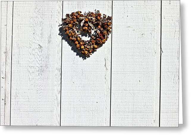 Heart wreath on wood wall Greeting Card by Garry Gay