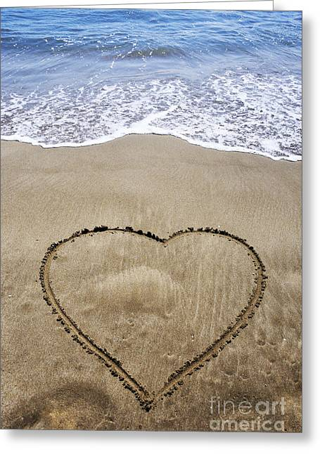 High Vulnerability Greeting Cards - Heartshape drawn in sand on beach Greeting Card by Sami Sarkis