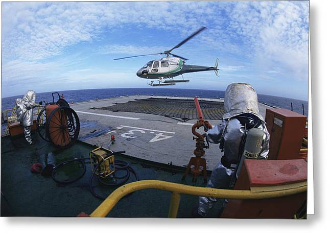 Drillship Greeting Cards - Helicopter Landing On A Drillship Greeting Card by Alexis Rosenfeld