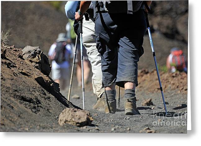 45-49 Years Greeting Cards - Hickers walking on volcanic dirt in the Haleakala crater Greeting Card by Sami Sarkis