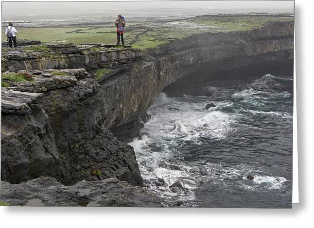 Inis Mor Greeting Cards - Hiking the Inis Mor Coastline Greeting Card by John Burnett