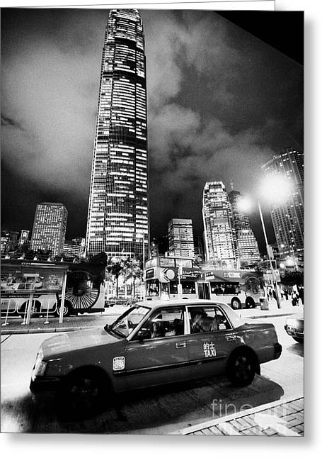 Taxi Stands Greeting Cards - Hong Kong Red Taxi At Taxi Rank At Night In Front Of International Finance Centre 2 On Hong Kong Greeting Card by Joe Fox