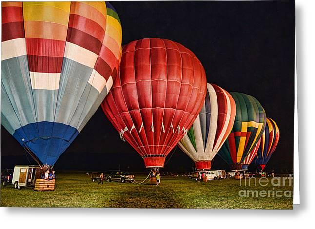 Baloon Greeting Cards - Hot Air Balloons night launch Greeting Card by Paul Ward