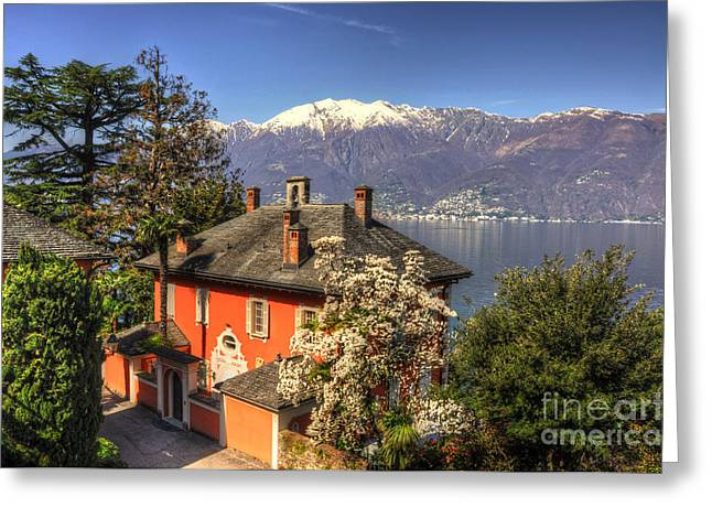 Snow Capped Greeting Cards - House on the lake front Greeting Card by Mats Silvan
