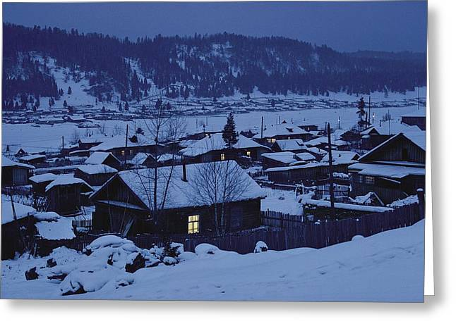 Houses In The Snow At Dusk Greeting Card by Dean Conger