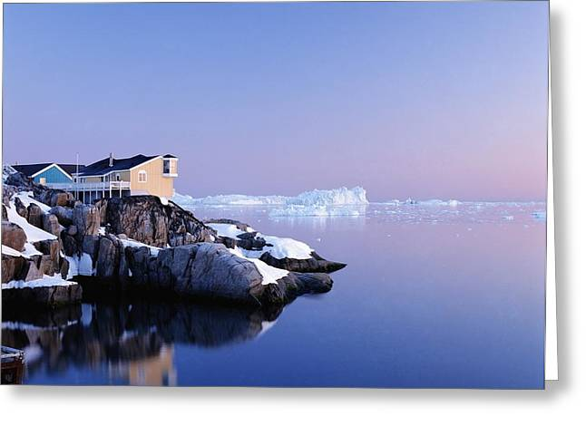 Snowy Night Night Greeting Cards - Houses On The Coastline With Icebergs Greeting Card by Axiom Photographic
