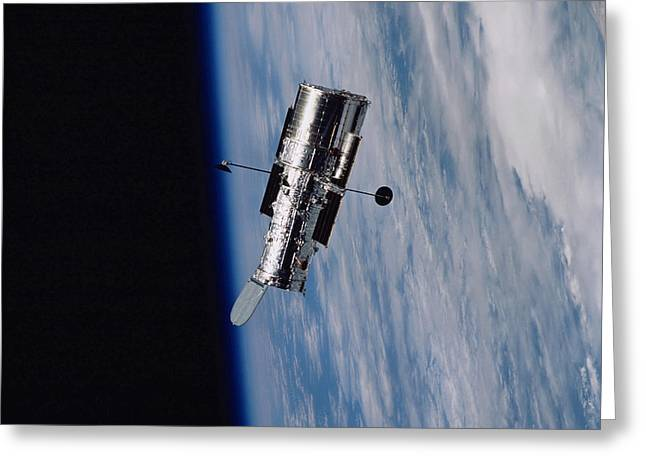 Hubble Space Telescope Views Greeting Cards - Hubble Space Telescope Backdropped Greeting Card by Stocktrek Images