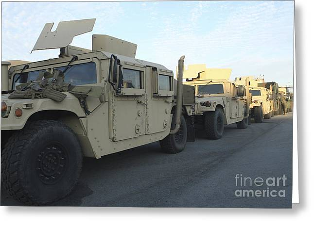Humanitarian Greeting Cards - Humvees Sit On The Pier At Morehead Greeting Card by Stocktrek Images