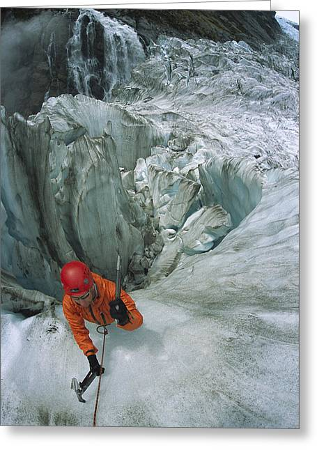 Ice Climber On Steep Ice In Fox Glacier Greeting Card by Colin Monteath