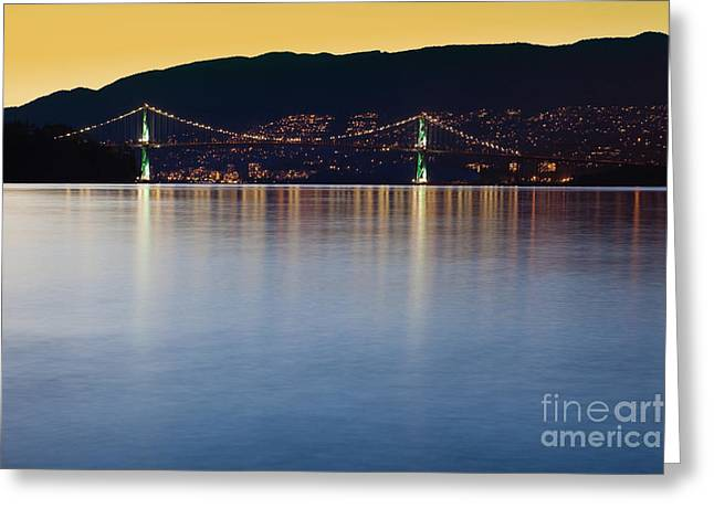 Burrard Inlet Greeting Cards - Illuminated Bridge Across a Bay Greeting Card by Bryan Mullennix