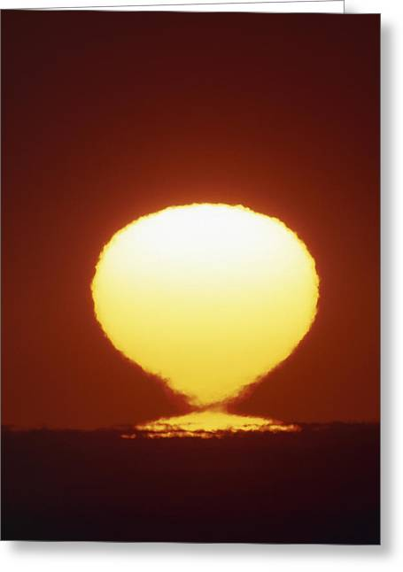Distortion Greeting Cards - Image Of A Distorted Sun Seen At Sunset Greeting Card by David Nunuk