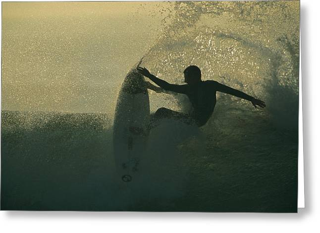 Surf Silhouette Greeting Cards - In A Spray Of Surf, A Surfer Leaps Greeting Card by Tim Laman