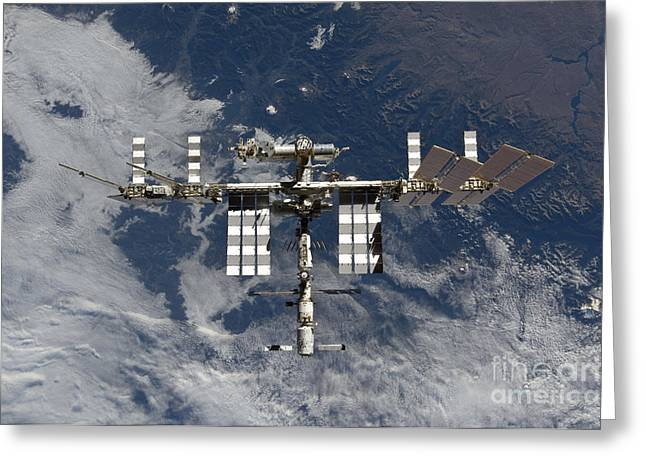 Component Greeting Cards - International Space Station Backgropped Greeting Card by Stocktrek Images