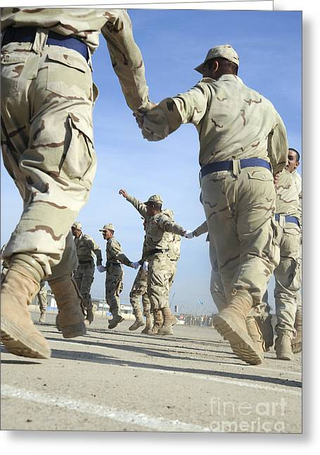 Bonding Greeting Cards - Iraqi Air Force Recruits Celebrate Greeting Card by Stocktrek Images