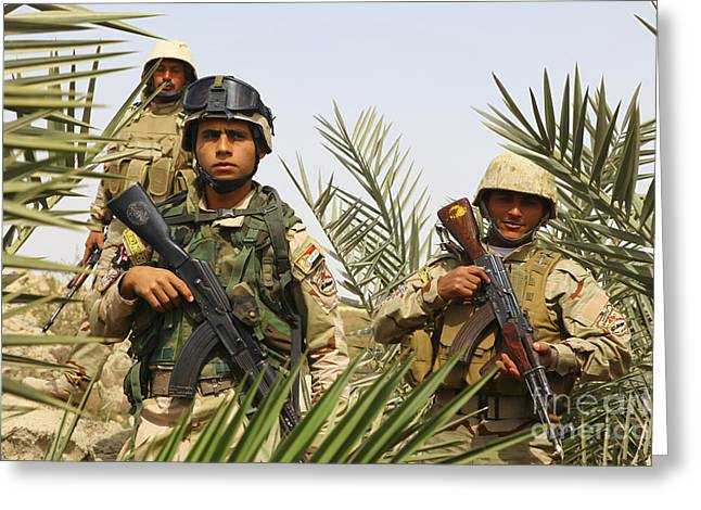 Iraq War Greeting Cards - Iraqi Soldiers Conduct A Foot Patrol Greeting Card by Stocktrek Images