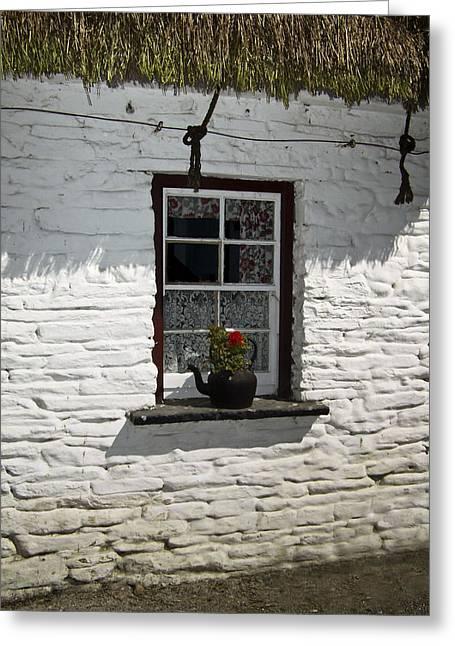 Thatch Greeting Cards - Irish Kettle of Geraniums County Cork Ireland Greeting Card by Teresa Mucha